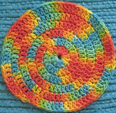 Double crochet stitches give this spiral hotpad an unusual look. The sample uses Peaches & Creme Mar-di-Gras yarn leftover from a knit dishcloth. It turned out better than I expected, and so I decided to add it to Ravelry.