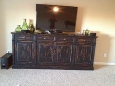 Tv console. Like the style of having 4 doors on bottom w drawers at the top and the basic flat bottom (no feet/legs)