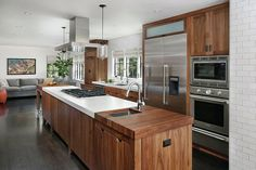 The Crosby Kitchen won a Watermark Grand Award for its rich wood finishes and practical ideas that make it a dream kitchen for any serious cook.