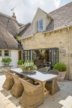 An airy extension gives the bijou proportions of this Cotwolds cottage a bright, light-filled contemporary feel. What better way to mix old and new? Outdoor Seating, Outdoor Rooms, Outdoor Living, Garden Cottage, Home And Garden, Exterior Design, Interior And Exterior, Porches, Cottage Extension