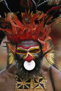 Papua New Guinea | Aboriginal man wearing tribal headdress with feathers from King of Saxony Bird of Paradise | ©Patricio Robles Gil