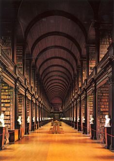 World's Most Beautiful Libraries - Trinity College Library/The Long Room (Dublin, Ireland). Features: The Book of Kells, a manuscript containing the four Gospels of the New Testament. Created by Celtic monks ca. Trinity Library, Trinity College Dublin, Oxford College, College Campus, Dublin Library, College Library, Dublin City, Libreria El Ateneo, Beautiful Library