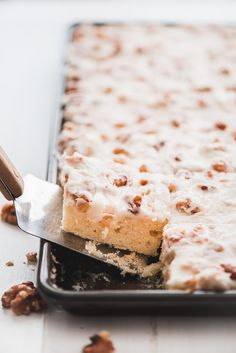 Here's an easy to bake, classic White Texas Sheet Cake recipe topped with a boiled white frosting that is loaded with toasted walnuts. Cupcakes, Cupcake Cakes, White Texas Sheet Cake, Sheet Cake Recipes, Sheet Cakes, Sweet Recipes, Yummy Recipes, Vegetarian Recipes, Coffee Cake