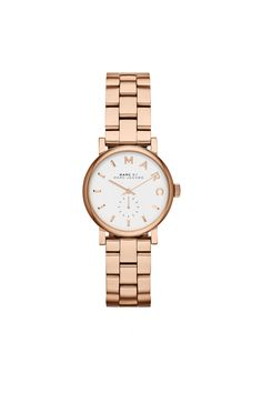 The Baker watch features classic, understated Marc by Marc Jacobs styling in a polished stainless steel watch with rose gold tone finish, round 28MM snapback case, and deployant buckle closure. White Pearlized dial with elegant rose gold tone 'Marc' logo, separate seconds dial, and beveled sticks & hands.