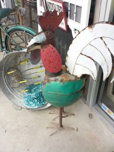 Metal rooster out front