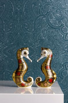 Having a symbolic meaning of patience, friendliness, protection, and contentment, the Old Imari Solid Gold Band Seahorse is designed in the striking and opulent Derby rich blue and red colours with lavishly 22 carat decoration. To add intrigue, there is a hidden historical reference in the tail showing the numbers, '11' on one side and '28' on the reverse. The original 1128 Old Imari pattern number is synonymous with Royal Crown Derby history.