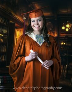 Cap and gown portrait in a burnt orange color. Portrait was taken in a studio environment.
