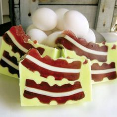 Bacon Soap is now available from handcrafted cleanliness experts Soapier. This glorious bar depicts a pair of streaky sow strips against a green background, and is deeply infused with the flavor of pig candy.