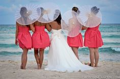 idk what that umbrella thing is… but i love the bridesmaids dresses!