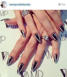 "#CNDProSpotlight: Nail Pro Vamp Nails (Instagram: @vampnailsleeds) created this ""Signature Vamp V"" design with #VINYLUX in Black Pool, Cream Puff and Steel Gaze. #NailArtistry"