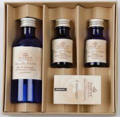 Altromercato - cofanetto olio da massaggio + oli essenziali rivitalizzanti