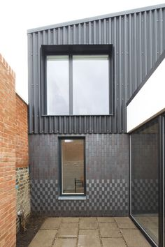 brick base + x cladding - new-build two-bed house squeezed on infill site - London - Dallas Pierce Quintero