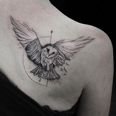 bw geometric owl shoulder tattoo
