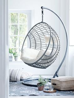 Made from durable materials that look just like light rattan, our impressive hanging chair has been intricately woven around a strong metal frame in a smooth egg shape. Big enough to snuggle up with a book and glass of wine, our stylish chair includes a sumptuously filled cream armchair seat cushion and headrest that are easily removable for storage and washing. As seen in The Sunday Times.
