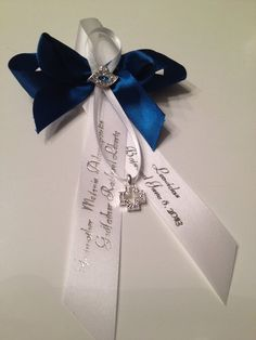 Witness pins are a Greek tradition at the baptismal ceremony. Our pins are individually hand sewn, using only the best satins, organza and cords.  Visit www.thepartycraftstore.com to see our vast selection.