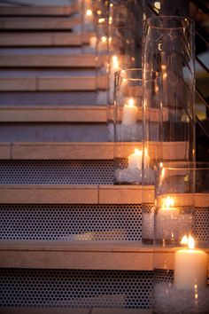 END OF NIGHT I WANT CANDLES IN TALL VASES ON STAIRS GOING OUT FRONT DOOR. Always try to accent a staircases.  Simple candles and vases are easy and they have a big impact.