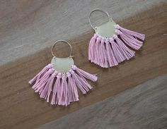 Stylishly blend metallic geometric shapes with bohemian embroidery floss fringe to make these Fantastic Fringe Brass DIY Earrings.