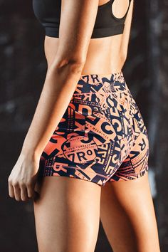 Pair kaleidoscope shorts with a black sports bra for a functional and bold training outfit.