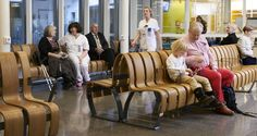 The Emergency Room at the University Hospital of Malmö, seating by Green Furniture Concept. Slightly curved and modular wooden benches in seamless seating rows.