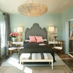 Fabulous, Sophisticated, and Feminine Bedroom. tiffany blue walls, black bedset with pink accent pillows, and the Chandelier!-pretty minus using pink as an accent.