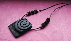 Charcoal spiral over matte black background