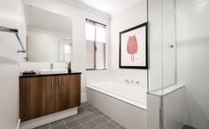 The main bathroom is spacious and features a semi inset basin, Caesarstone benchtops and a bath