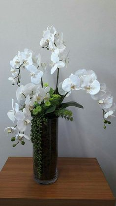 Elegant arrangement with white orchids! Elegant arrangement with white orchids! Elegant arrangement with white orchids! Elegant arrangement with white orchids! Orchid Flower Arrangements, Modern Floral Arrangements, Artificial Flower Arrangements, Vase Arrangements, Floral Centerpieces, Flower Vases, Ikebana, Deco Floral, White Orchids