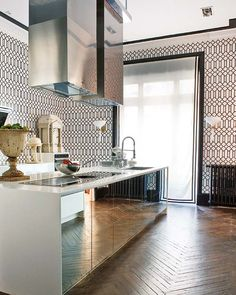 Mirrored Cabinets in the kitchen, herringbone floors and cool trellis wallpaper #design