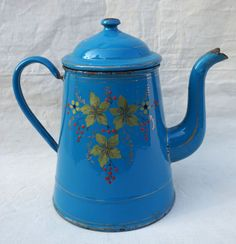 ". French blue enamelware coffee pot with hand pâinted flowers and gilt borders made during the 1900's. 8 5/8"" height 11"" width. Good conditions a few rust stanis and enamel shortage."