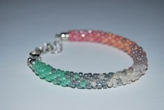 Delicate Rainbow Pattern Beaded Bracelet made with TOHO beads - handmade using the Kumihimo technique by BeaduBeadu on Etsy