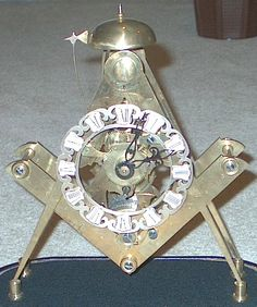 Masonic Square and Compasses Mantle Clock, hand made by a master clockmaker who is now retired and lives in Alabama.