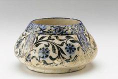 Iran 1200-1300 | Ceramic; modeled, glazed, and fired bowl blue, white black floral