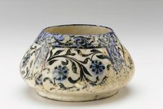 Iran 1200-1300 | Ceramic; modeled, glazed, and fired bowl blue, white black floral