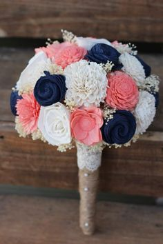 Thank you for looking. I hope to work with you on your floral needs. This listing features a bouquet features shell flowers, roses, mums, carnations and zinnias in English navy, coral and ivory. This bouquet has cream filler and is wrapped in burlap and accented with a lace collar with pearls. Any of these flower colors may be hand dyed in your very special wedding palette colors. The picture above shows a medium size. It measures 25 inches around the whole flower ball. Size is…