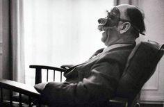 Eugène Ionesco avec sa collection de masques, Paris (bld du Montparnasse), 1965 -by Jean Mounicq. From: 'Portraits pour un siècle, cent écrivains',  choix de textes par Brigitte Besse. Gallimard & Roger-Viollet, 2011