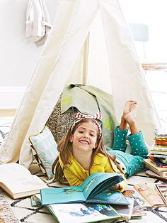 Want your child to fall in love with books? Flip through our top tips to raise a reader.