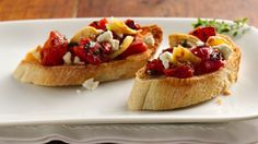Fire rosted tomatoes, goat cheese and fresh thyme leaves are the signature flavors of a classic Italian appetizer.