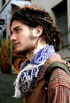 Dont get me wrong, not everyone can pull of dreads, but if you pull off that shirt and scarf and man purse, you can pull off the dreads...