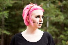 Need a last minute Halloween costume? This easy DIY cat costume is perfect if you don't want to spend much on a costume and want a cute and comfortable costume. Click through to get a FULL tutorial on this easy cat makeup using stuff you probably already have in your makeup bag!
