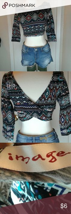 Image shirt Native print Image shirt.  It is 96 percent cotton and 4 percent spandex. Image Tops Crop Tops