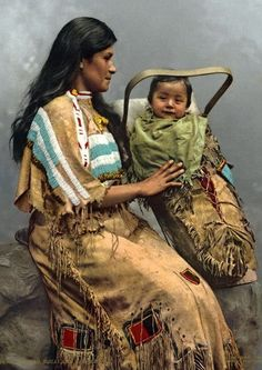 Chippewa Woman and Infant, 1900 [Photo Courtesy of pinegreenwoods.com] —