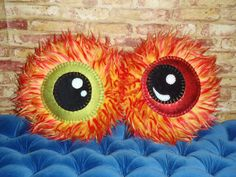 Flame Monster  Furry Round Eyeball Pillow by PityPartyPillowParts. Set of colorful fun and funky eyes.