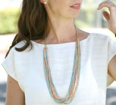 Seed bead necklace. I think I'd do it with beading wire and crimping beads rather than filament.