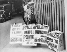 Evening newspaper placards in London announce the news of Germany's invasion of Poland on 1 September 1939.