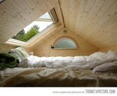 The perfect place to look at the stars…AWESOME attic bed & window.   <3