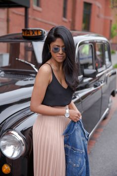 Nude pleated skirt + black silk tank top + jean jacket