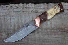 Meteorite damascus blade with Copper fittings, Musk ox horn and Ironwood handles