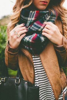 plaid scarf. brown leather jacket.