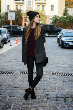 Shop this look on Lookastic:  http://lookastic.com/women/looks/beanie-crew-neck-t-shirt-coat-satchel-bag-skinny-jeans-socks-ankle-boots/4836  — Black Beanie  — Burgundy Crew-neck T-shirt  — Charcoal Coat  — Black Leather Satchel Bag  — Charcoal Skinny Jeans  — Burgundy Socks  — Black Leather Ankle Boots
