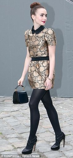 Going for gold: Lily accessorised with a small black bag and tights with heels